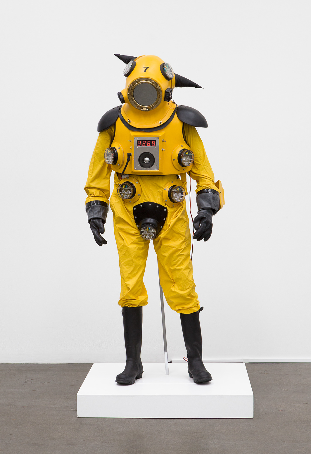 "Kenji Yanobe, Atom Suit, 1987, Geiger counter, PVC, strobe light, mixed media, 71 x 30 3/4 x 23 1/8""."