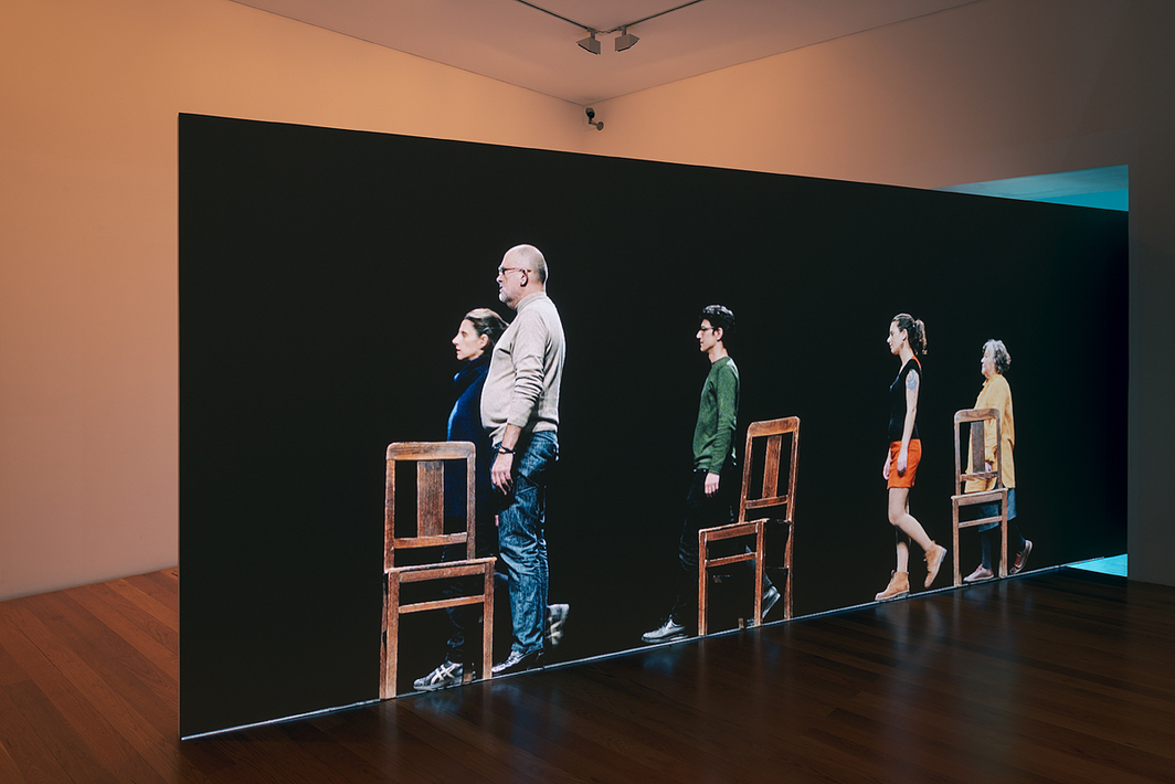 João Fiadeiro, Romain Bigé, and Rui Xavier, Waiting, Walking, Standing and Sitting, 2019, after Steve Paxton's Satisfyin Lover (1967). 4K video installation, color, sound, 14:16.