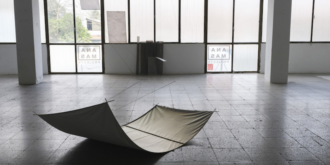 "Milena Rossignoli, Tendø, 2019, reflective nylon, wood, rope, and carbon, 76 x 48 x 24 1/2""."