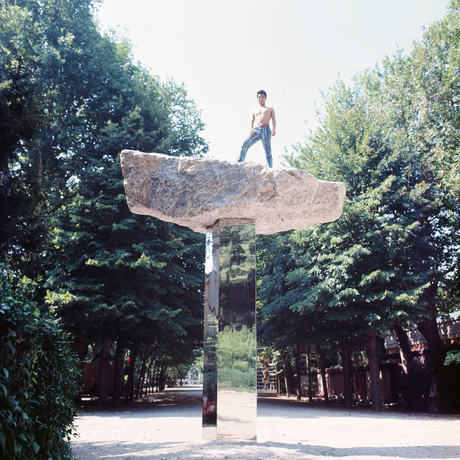 Nobuo Sekine with his sculpture Phase of Nothingness, 1969/70, at the Japanese Pavilion at the 35th Venice Biennale, 1970. Photo: Yoriko Kushigemachi.