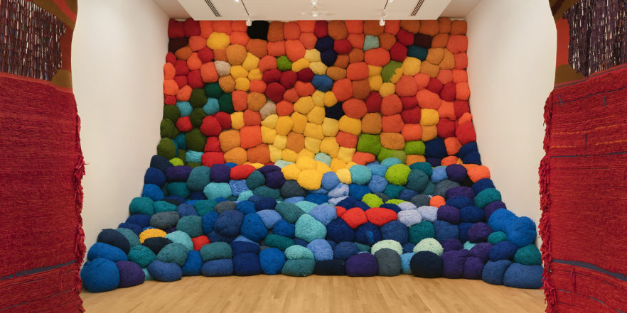 Sheila Hicks, Escalade Beyond Chromatic Lands, 2016–17, fibers, dimensions variable. Installation view, Bass Museum of Art. Photo: Zachary Balber.