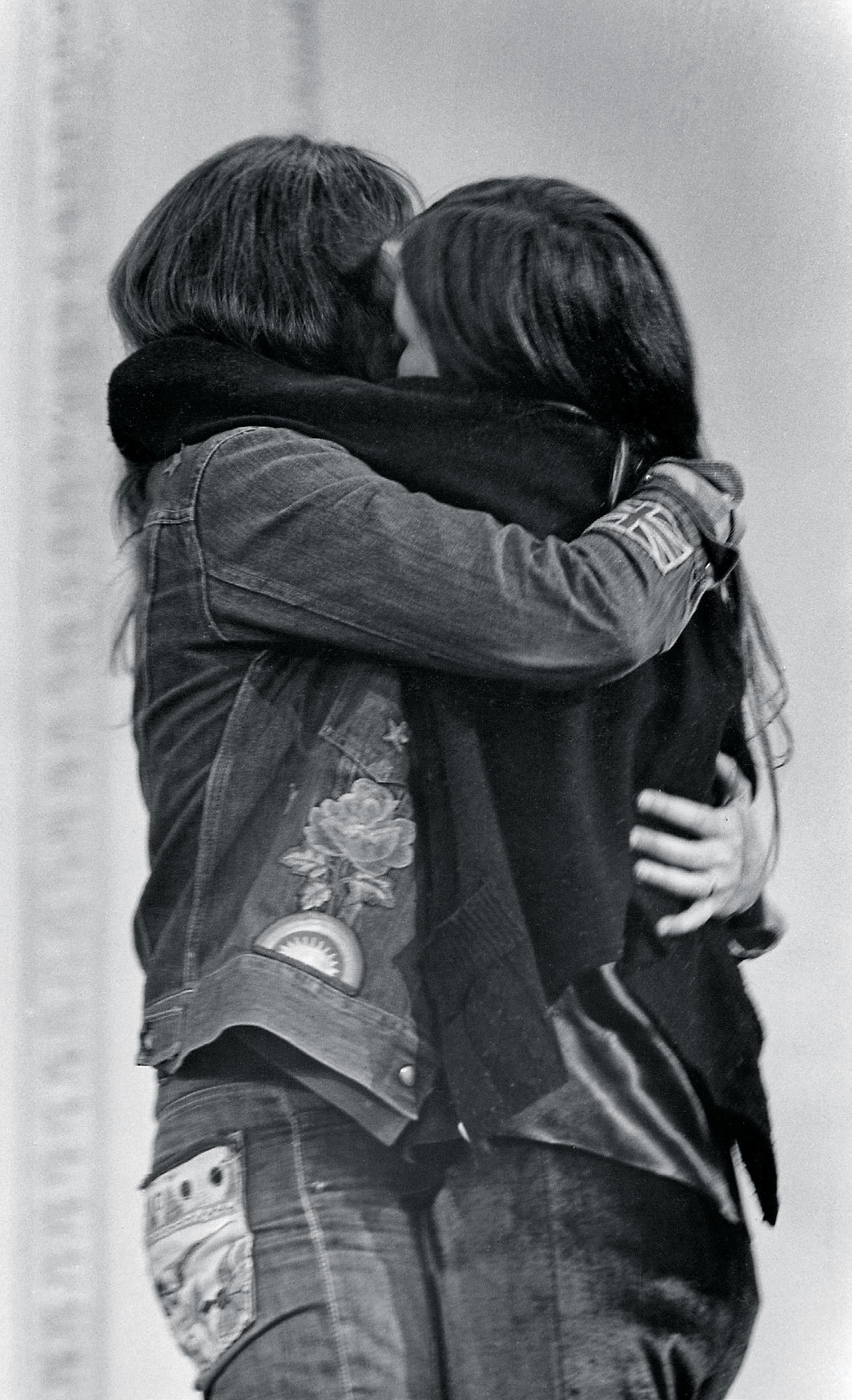 "Jill Johnston and an unidentified woman embrace onstage during ""A Dialogue on Women's Liberation,"" Town Hall, New York, April 30, 1971. Photo: Fred W. McDarrah/Getty Images."