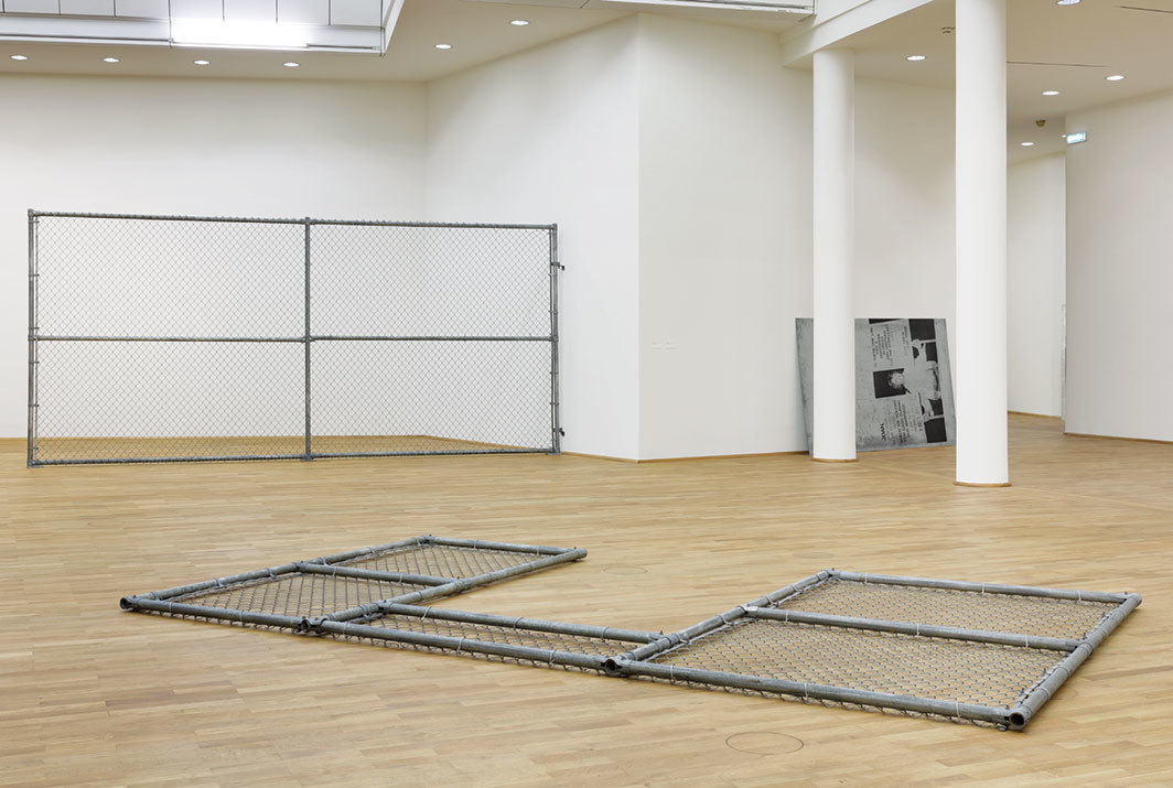"View of ""Cady Noland,"" 2018–19. Foreground: Institutional Field, 1991. Background, from left: Industrial Park, 1991; Joan, Is There One Law?, 1994. Photo: Axel Schneider."