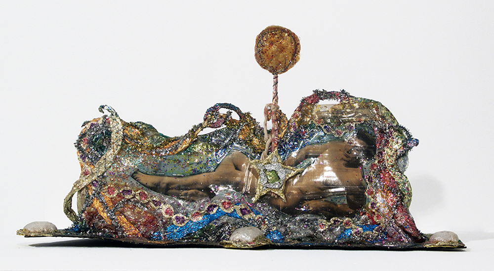 "Thomas Lanigan-Schmidt, Lollipop Knick Knack (Let's Talk About You), ca. 1968–69, foil, printed material, linoleum, glitter, staples, Magic Marker, found objects and other media, 9 x 16 x 5 1/2""."
