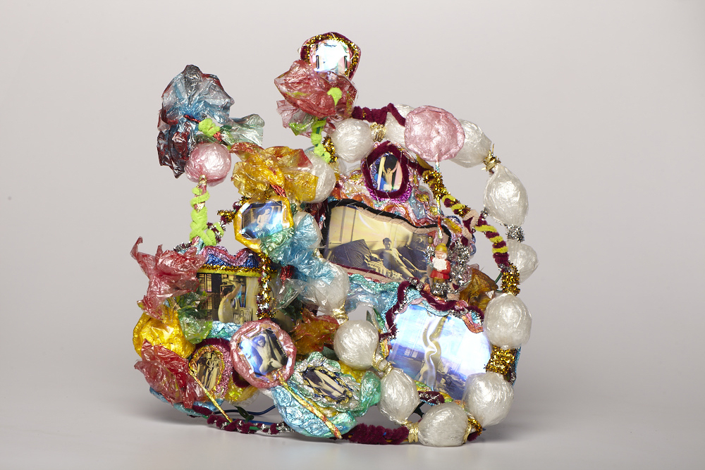 "Thomas Lanigan-Achmidt, Untitled (Crown), 1995, aluminum foil, plastic wrap, holographic tape, pipe cleaners, glitter, staples, 12 1/2 x 8 x 10""."