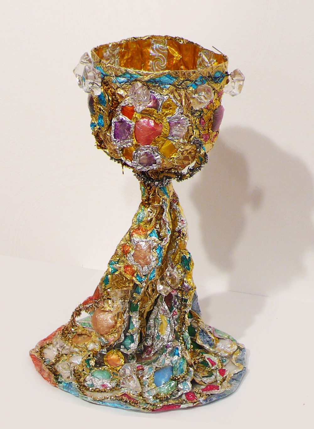 "Thomas Lanigan-Schmidt, Chalice Iv, ca. 1990s, aluminum foil, plastic wrap, holographic tape, pipe cleaners, glitter, staples, colored marker, 12 1/2 x 7 x 7""."
