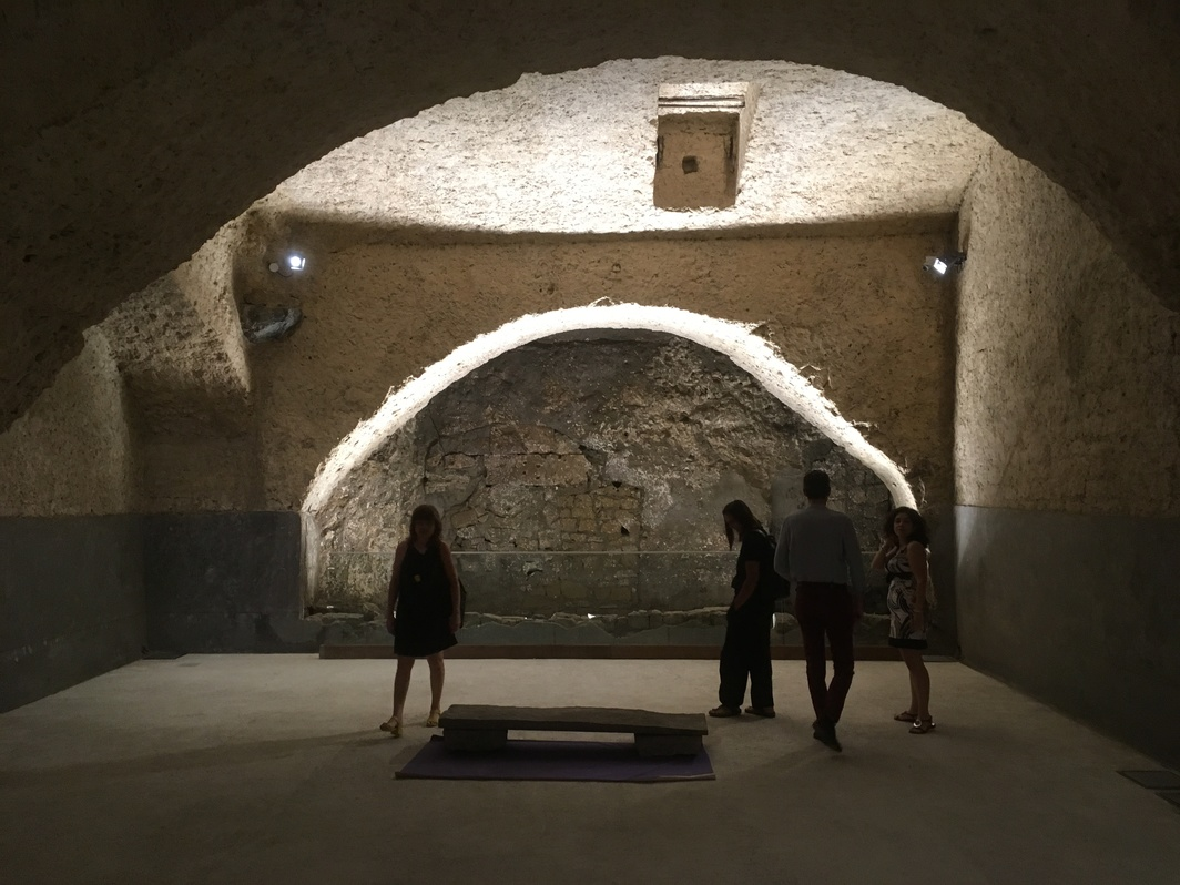 Basement of Fondazione Morra Greco with Jimmie Durham installation.