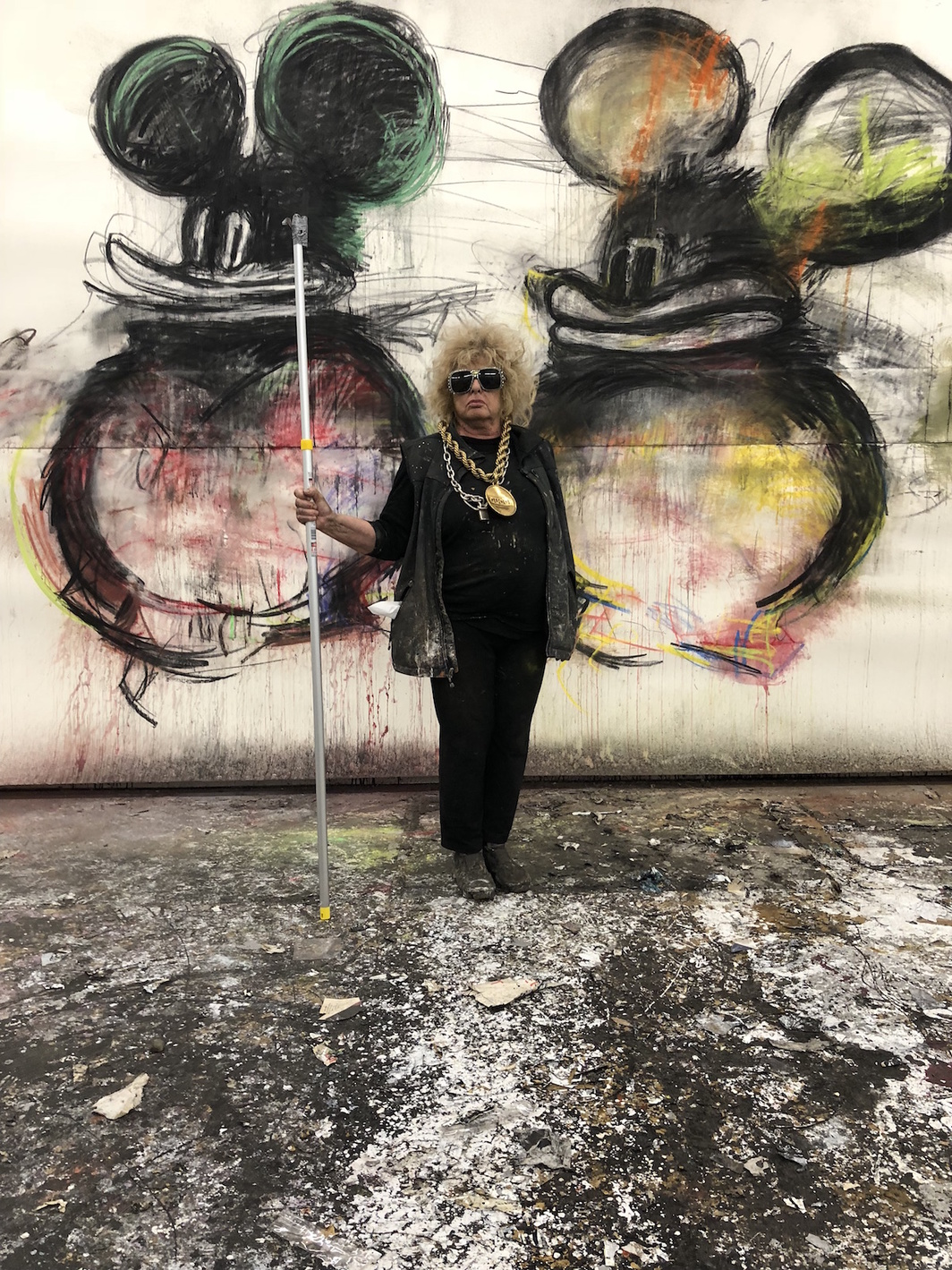 Joyce Pensato in front of Take Me to Your Leader, 2018.