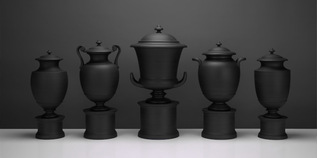 "Matthew Warner, Garniture II, 2019, black stoneware, 17 x 47 x 9""."