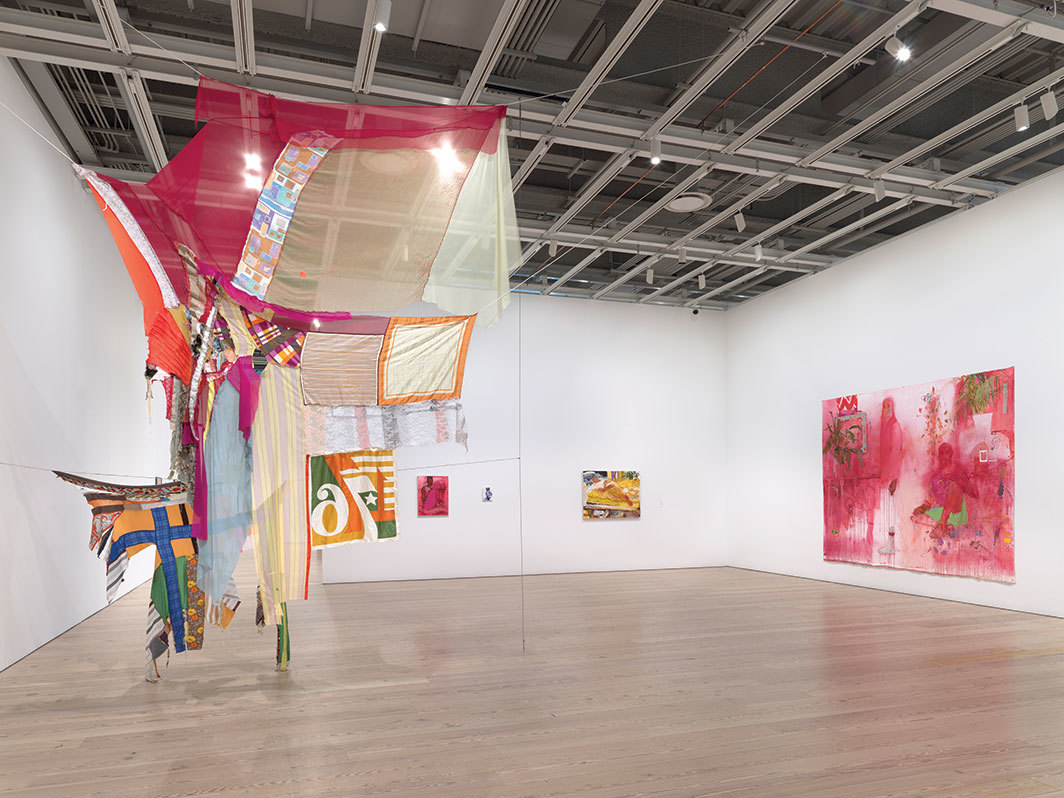 View of 2019 Whitney Biennial, Whitney Museum of American Art, New York. From left: Eric N. Mack, Proposition: for wet Gee's Bend Quilts to replace the American flag—Permanently, 2019; Jennifer Packer, Untitled, 2019; Jennifer Packer, An Exercise in Tendernesses, 2017; Jennifer Packer, Untitled, 2019; Jennifer Packer, A Lesson in Longing, 2019. Photo: Ron Amstutz.