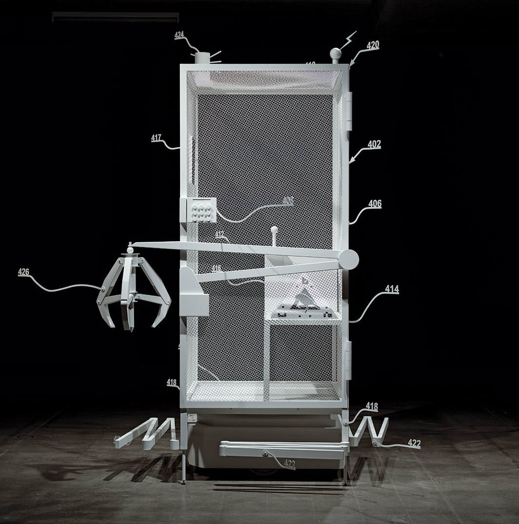 "Simon Denny, Amazon worker cage patent drawing as virtual King Island Brown Thornbill cage (US 9,280,157 B2: ""System for transporting personnel within an active workspace,"" 2016), 2019, powder-coated metal, MDF, plastic, UV print on cardboard, iOS augmented reality interface. Installation view, Museum of Old and New Art, Hobart, Australia. Photo: Jesse Hunniford."