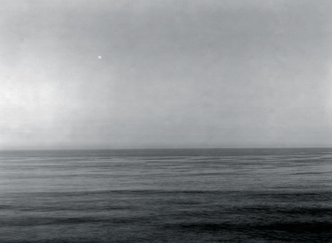 "Thomas Joshua Cooper, Moonrise over Montauk—The North Atlantic Ocean, Montauk Point, ""The End,"" East Hampton Township, (South Fork) Suffolk County, Long Island, New York, 2016–2017, gelatin silver print, 30 × 40""."