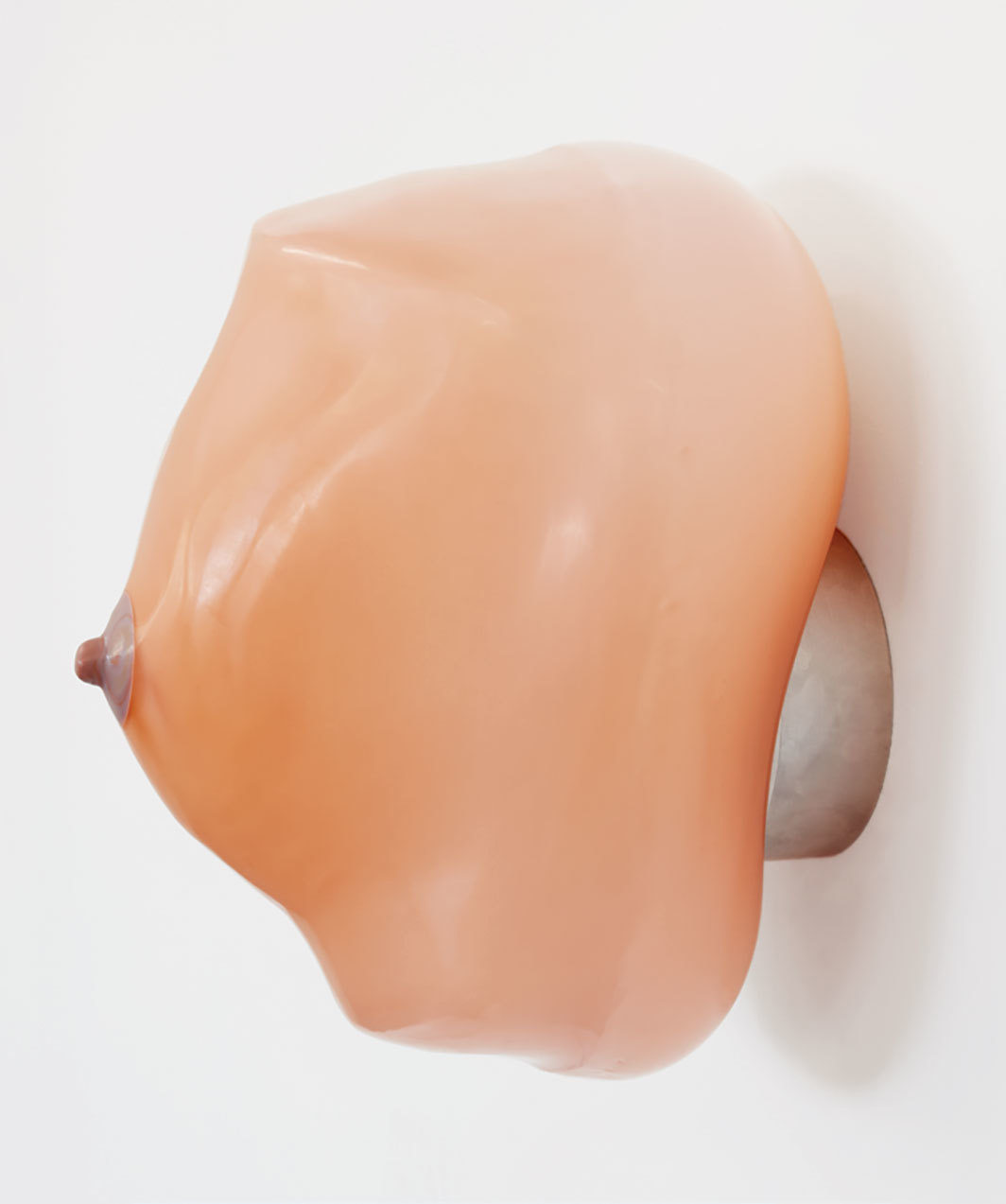 "Nevine Mahmoud, breast (Rosa Alptraum), 2019, handblown glass, resin, aluminum hardware, 10 × 7 1⁄8 × 7 1⁄2""."