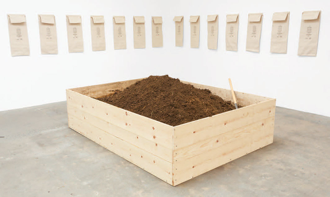 Helen Mayer Harrison and Newton Harrison, On Making Earth, 1970–, manure, soil, worms, wood, burlap sacks, dimensions variable.