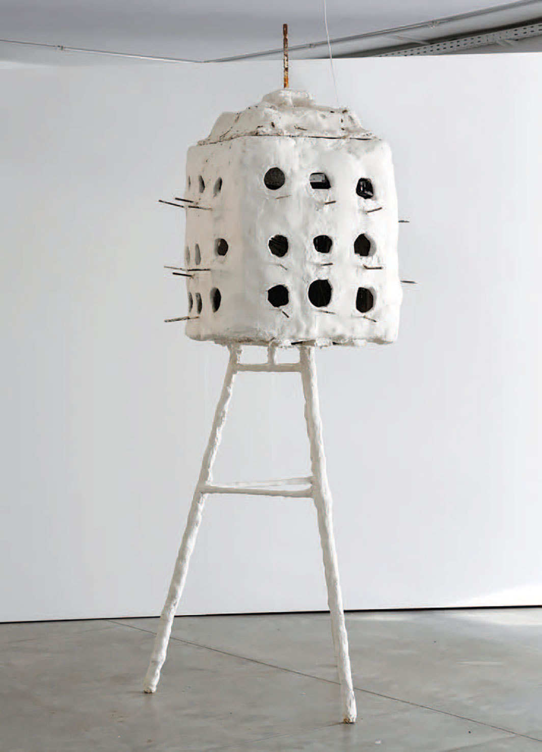 "Alex Ayed, Untitled (Beit El Hmam) (Pigeon House), 2019, steel, plaster, and pigeons, 12' 1⁄8"" ×  3' 3 3⁄8"" × 4' 3 1⁄8""."
