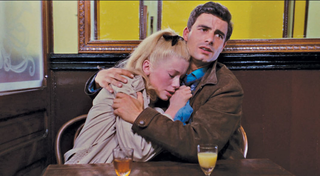 Jacques Demy, The Umbrellas of Cherbourg, 1964, 35 mm, color, sound, 91 minutes. Geneviève Emery (Catherine Deneuve) and Guy Foucher (Nino Castelnuovo).