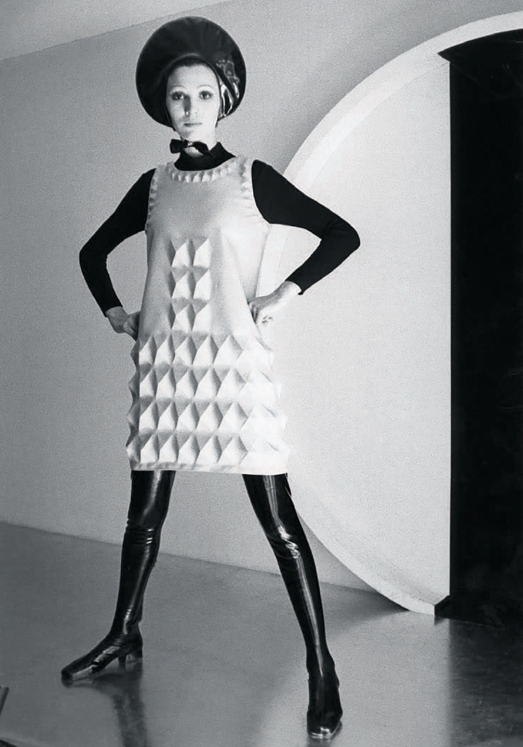 Pierre Cardin, dress with vinyl boots, gloves, and Halo hat, 1968, gelatin silver print, 10 × 6 1⁄2""