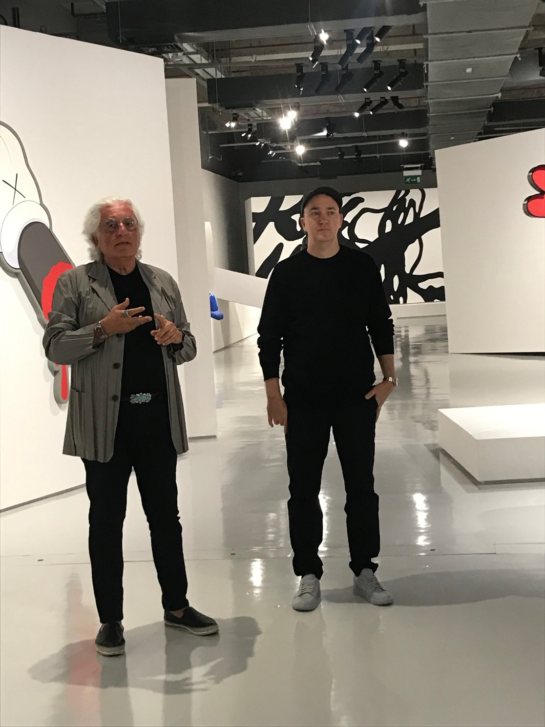 Curator Germano Clement and artist Brian Donnelly (a.k.a. KAWS).