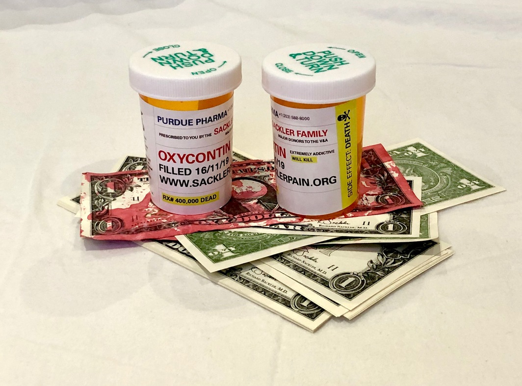 Fake OxyContin bottles and printed US one-dollar bills that were used by demonstrators during a protest at the Victoria and Albert Museum in London on Saturday, November 16. Courtesy of P.A.I.N.