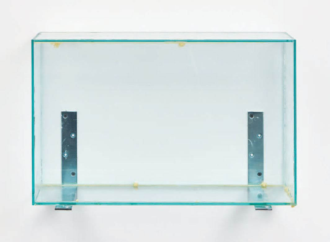 "Henrik Olesen, Glass Box Low, 2019, glass, glue, metal brackets, 16 × 24 3⁄8 × 7 7⁄8""."