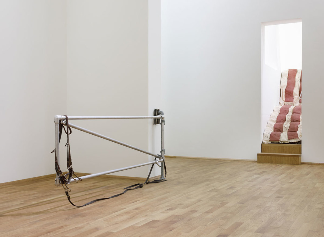 "View of ""Cady Noland,"" 2018–19, Museum für Moderne Kunst, Frankfurt. From left: Cady Noland, Corral Gates, 1989; Claes Oldenburg, Bacon/Caport, 1991. Photo: Axel Schneider."