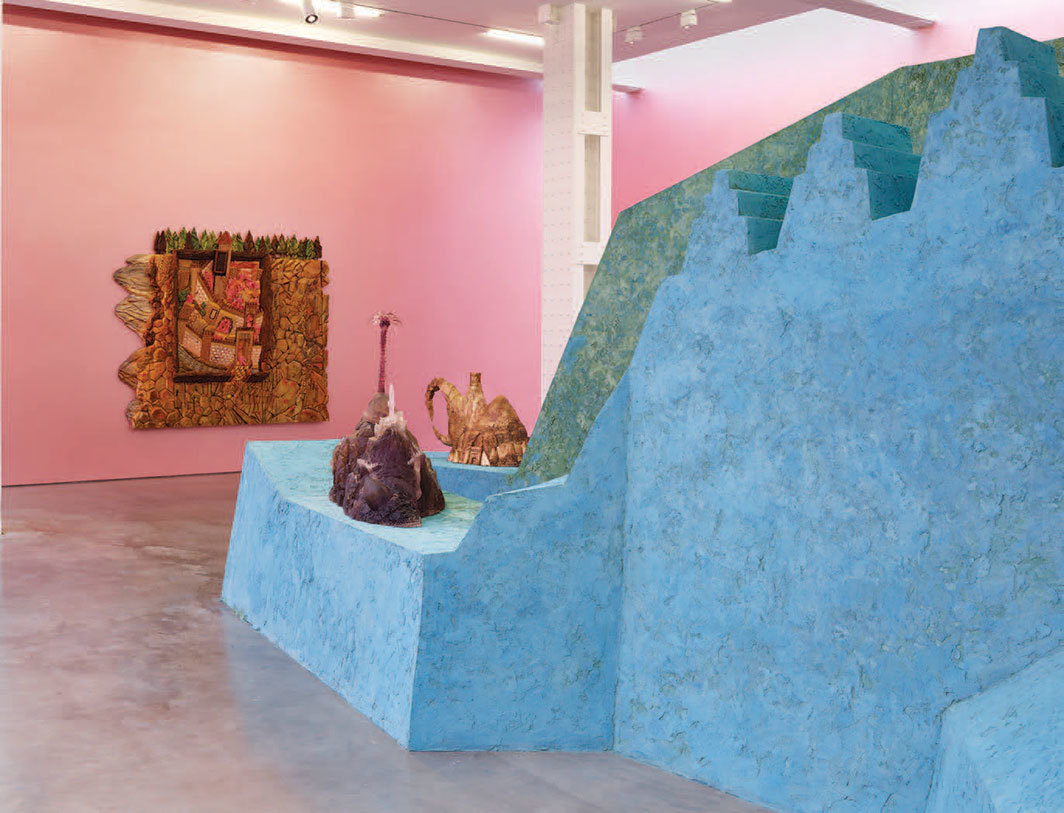 "View of ""Wael Shawky,"" 2019. Background: The Gulf Project Camp: Carved wood (after 'Nighttime in a City' by Mir Sayyid Ali, c.1540), 2019. Foreground, from left: The Gulf Project Camp: Glass Sculpture # 1, 2019; The Gulf Project Camp: Sculpture # 5, 2019."