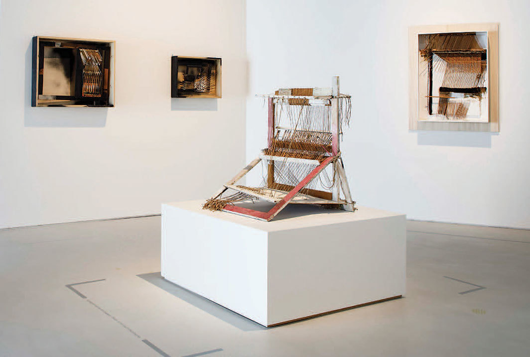 "View of ""Maria Lai,"" 2019. Background, from left: Una finestra sul mondo (A Window on the World), 1966; Una finestra sul mondo II (A Window on the World II), 1966; Telaio (Looms), 1965. Foreground: Oggetto paesaggio (Landscape Object), 1967."