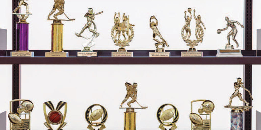 "Diamond Stingily, In the Middle but in the Corner of 176th Place (detail), 2019, trophies; four metal shelves, each 7' 2 5⁄8"" × 14' 9 1⁄8"" × 2' 1 5⁄8""."
