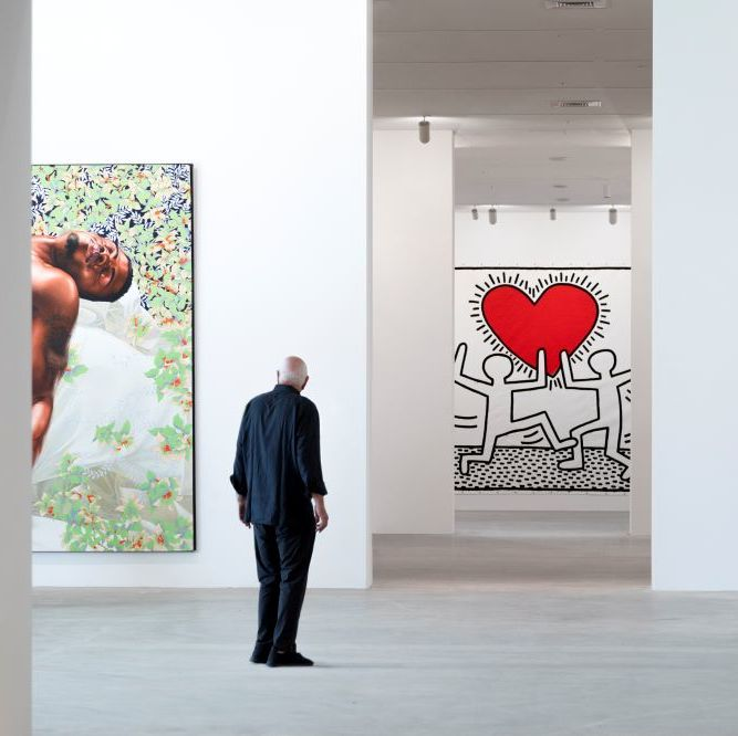 Don Rubell in front of works by Kehinde Wiley and Keith Haring at the Rubell Museum. Courtesy of the Rubell Museum.