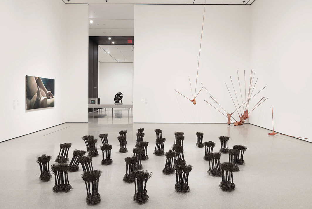 "View of ""Hardware/Software,"" 2019–, Museum of Modern Art, New York. Foreground, from left: Joan Semmel, Night Light, 1978; Maren Hassinger, Leaning, 1980; Senga Nengudi, R.S.V.P. I, 1977/2003. Background: Cady Noland, Tanya as Bandit, 1989. Photo: John Wronn."