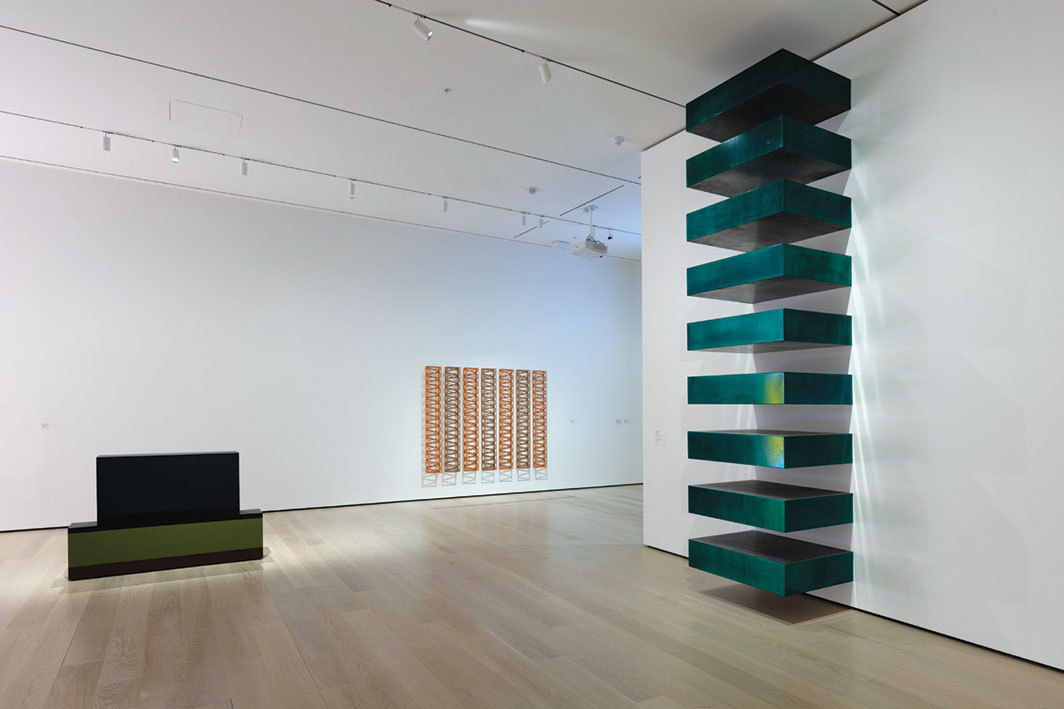 "View of ""Breaking the Mold,"" 2019–, Museum of Modern Art, New York. From left: Anne Truitt, Catawba, 1962; Rasheed Araeen, (3+4) SR, 1969; Donald Judd, Untitled, 1967. Photo: John Wronn."