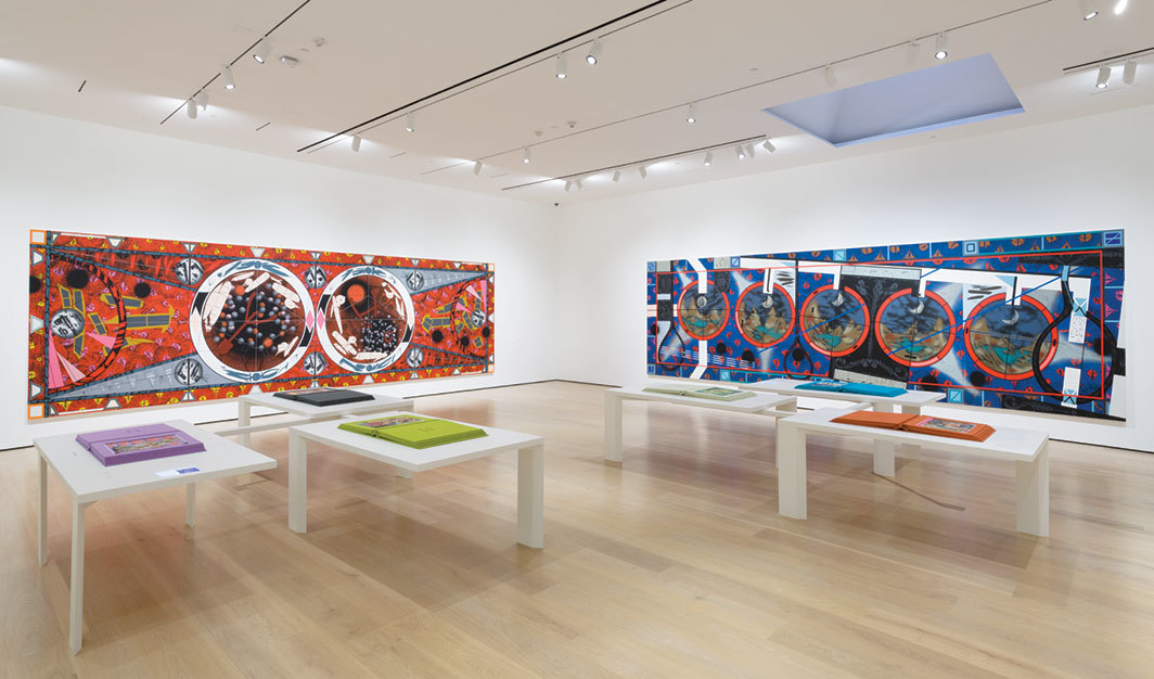 "View of ""Lari Pittman: Declaration of Independence,"" 2019–20, Hammer Museum, Los Angeles. Wall, from left: Flying Carpet with Petri Dishes for a Disturbed Nation, 2013; Flying Carpet with a Waning Moon over a Violent Nation, 2013. Tables: A History of Human Nature, 2017. Photo: Jeff McLane."