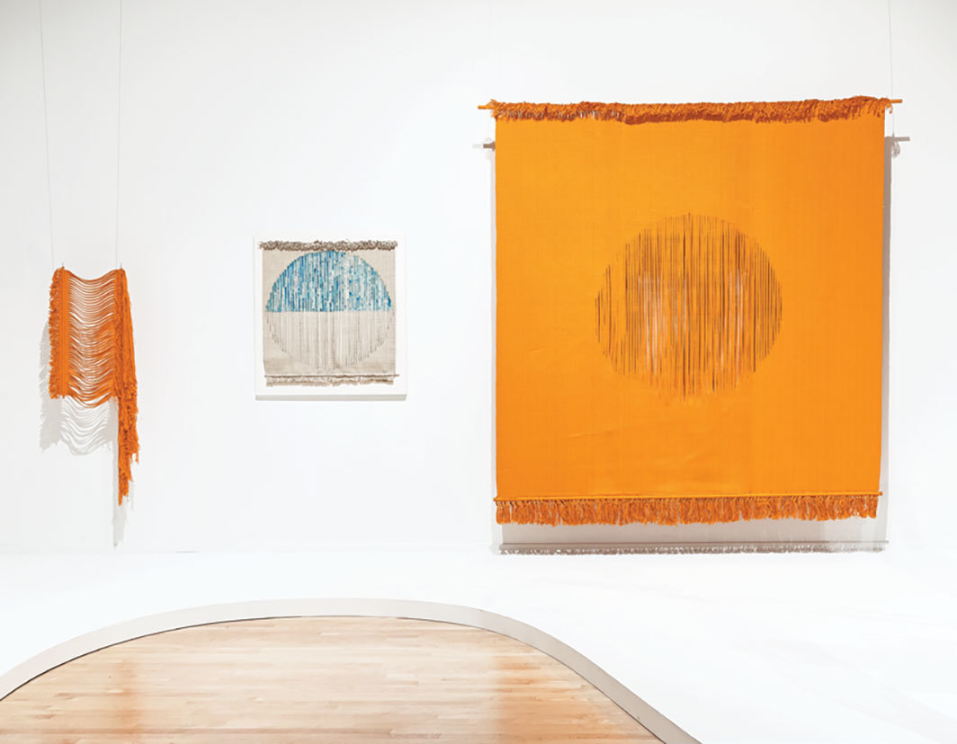 "View of ""In Poetry and Silence: The Work and Studio of Lenore Tawney,"" 2019–20. From left: Waterfall, 1974; Waters Above the Firmament, 1976; In Fields of Light, 1975."