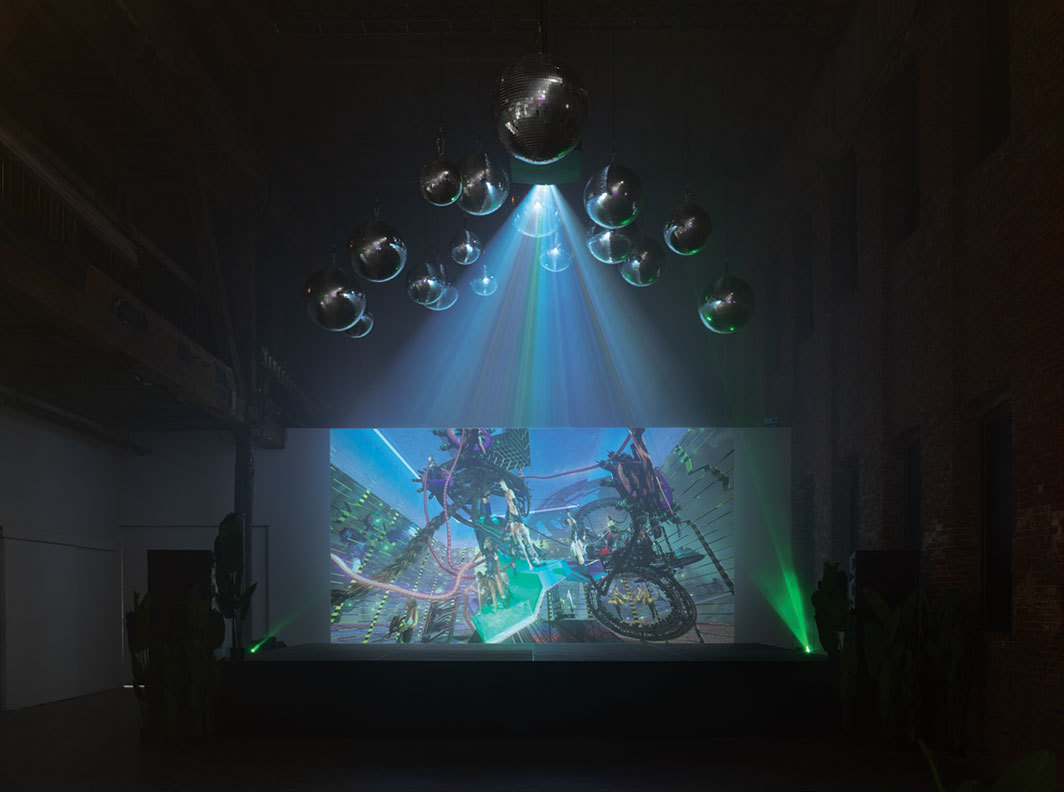 Jacolby Satterwhite, Blessed Avenue, 2018, disco balls, lights, potted plants, HD video (color, sound, 19 minutes 19 seconds). Installation view.