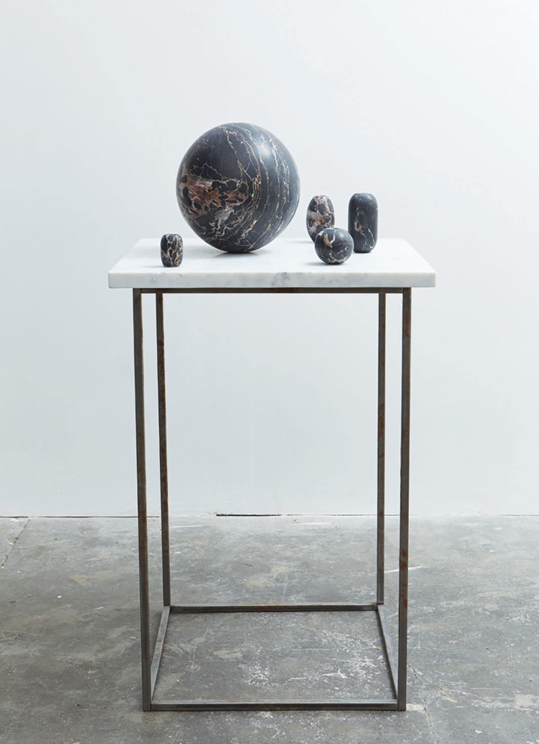 "Rana Begum, No. 881 Floats, 2019, marble, metal, 45 1⁄4 × 23 5⁄8 × 23 5⁄8""."