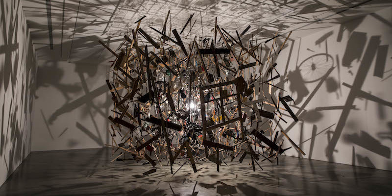 Cornelia Parker, Cold Dark Matter: An Exploded View, 1991, blown up garden shed and contents, wire, light bulb, dimensions variable.