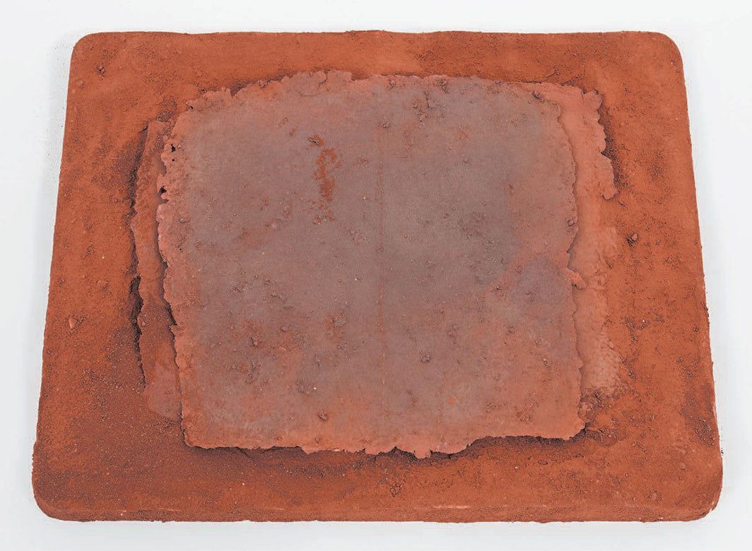 "Michelle Stuart, Project for a Chart of the Earth Reflecting the Sky, 1983, plaster, handmade paper, earth from Zagora, Morocco, 17 1⁄2 × 21 1⁄2 × 2""."