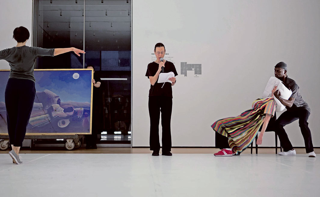 Yvonne Rainer, The Concept of Dust, or How do you look when there's nothing left to move?, 2015. Performance view, Werner and Elaine Dannheisser Lobby Gallery, Museum of Modern Art, New York, June 2015. From left: Emmanuèle Phuon, Yvonne Rainer, Pat Catterson, David Thomson. Photo: Julieta Cervantes.