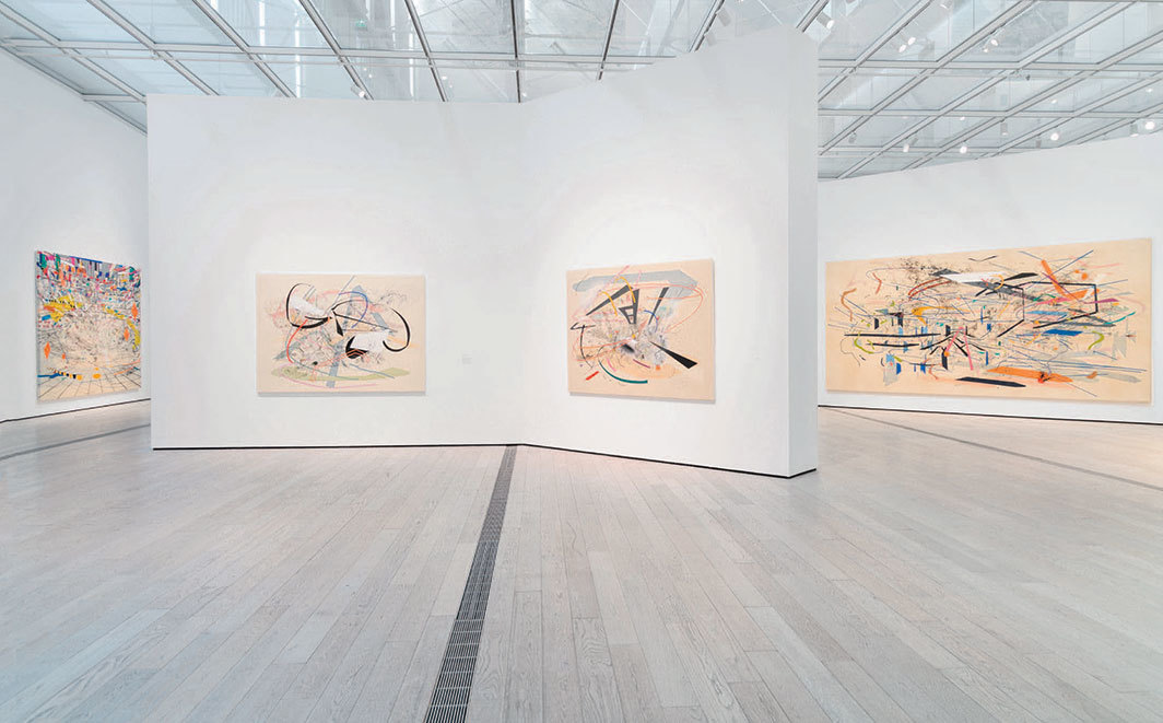 "View of ""Julie Mehretu,"" 2019–20, Los Angeles County Museum of Art. From left: Stadia II, 2004; Babel Unleashed, 2001; Untitled 2, 2001; Retopistics: A Renegade Excavation, 2001."