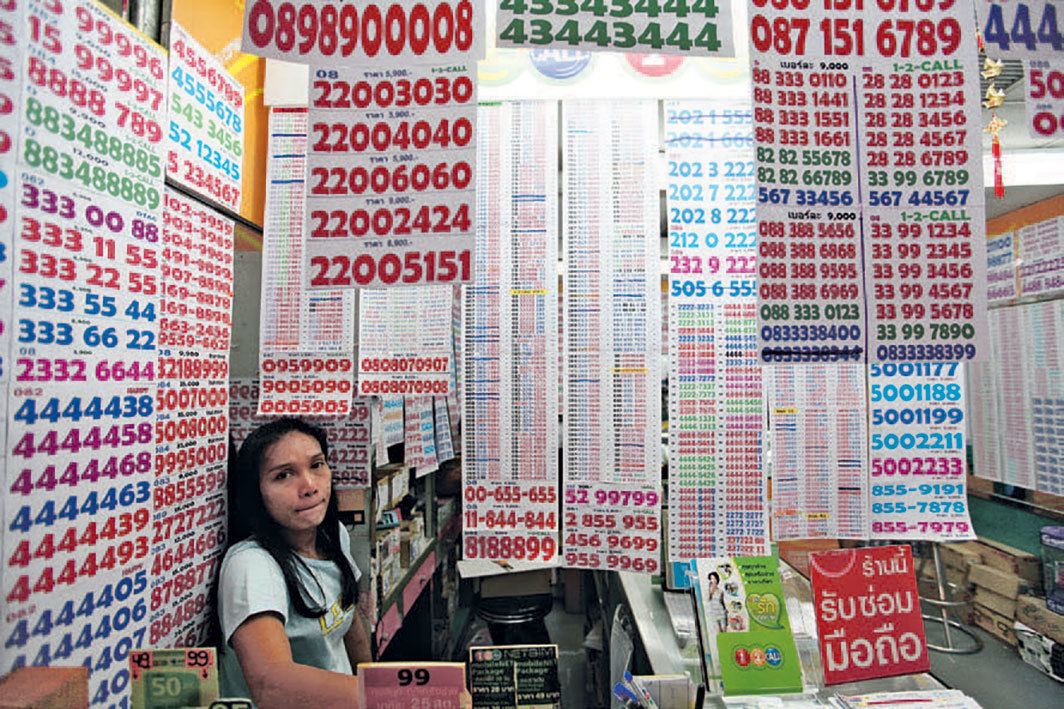 *A vendor at the MBK Center shopping mall, Bangkok, September 17, 2010.* Photo: Damir Sagolj/Reuters.