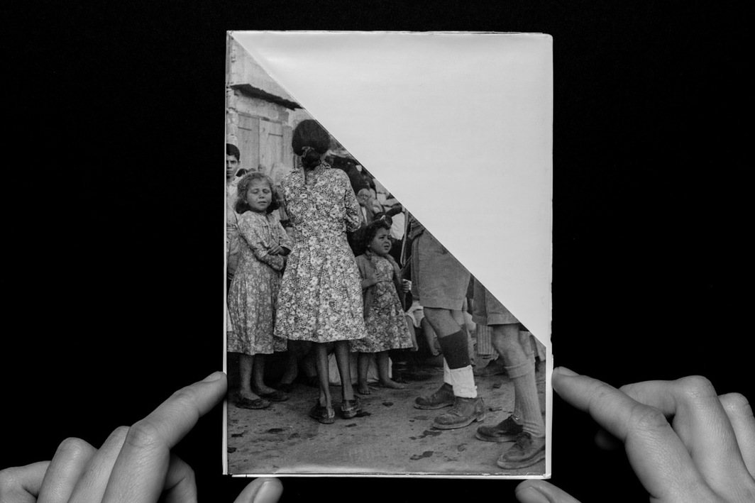 "Folded photograph of the expulsion of Palestinians from Ramle, 1948. From Ariella Aïsha Azoulay's exhibition ""Potential History,"" 2012, various locations."