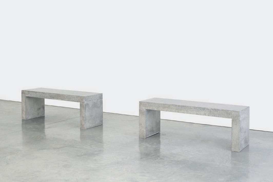"Teresa Margolles, Dos bancos (Two Benches), 2020, cement and mixed media, each 19 3⁄4 × 17 3⁄4 × 55 1⁄8""."