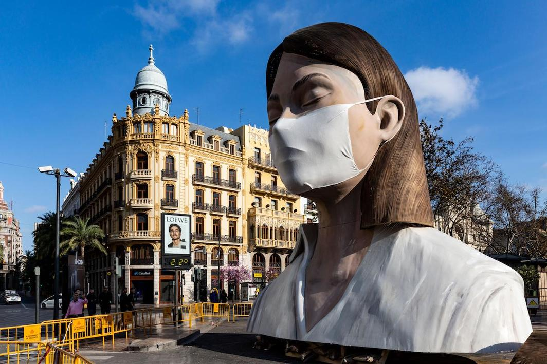 A sculpture from the canceled 2020 Las Fallas festival in Valencia, Spain, wearing an improvised mask. Photo: John McKenna / Alamy.