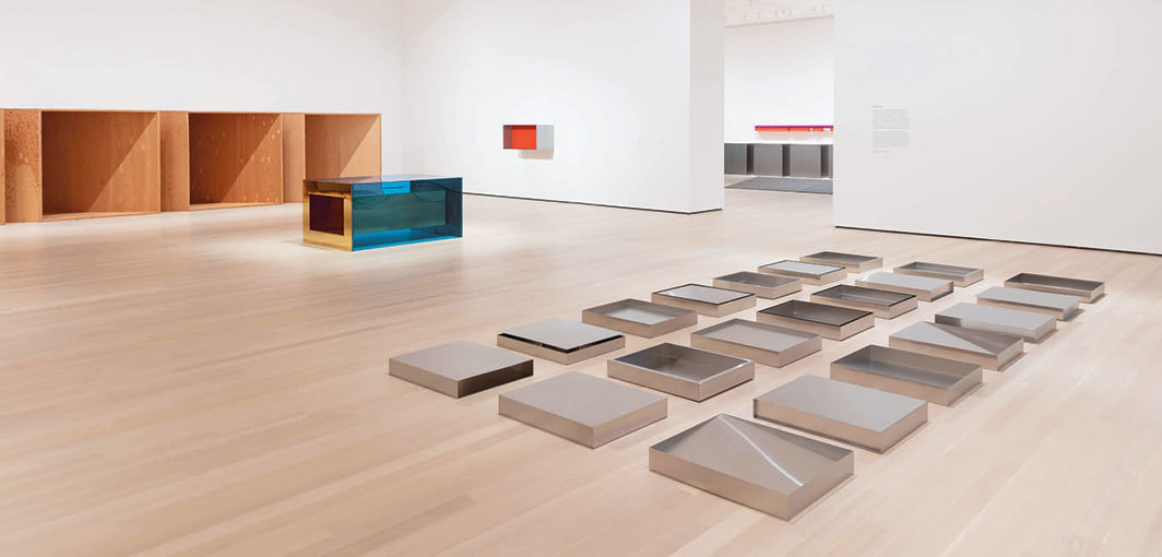 "View of ""Judd,"" 2020, Museum of Modern Art, New York. Background, from left: untitled, 1973; untitled, 1973; untitled, 1977. Foreground: untitled, 1976–77. Photo: Jonathan Muzikar. © Judd Foundation/Artists Rights Society (ARS), New York."