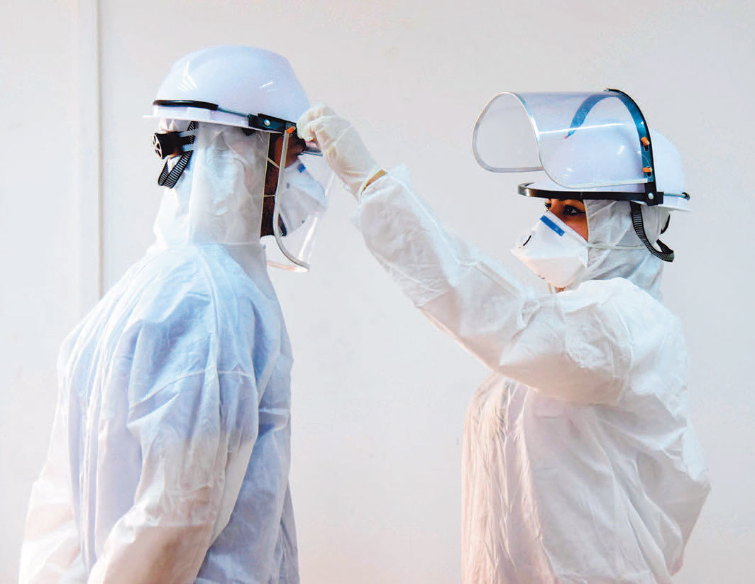 Nurses in a Covid-19 quarantine unit, Baghdad Medical City, April 8, 2020. Photo: Murtaja Lateef/EPA-EFE/Shutterstock.