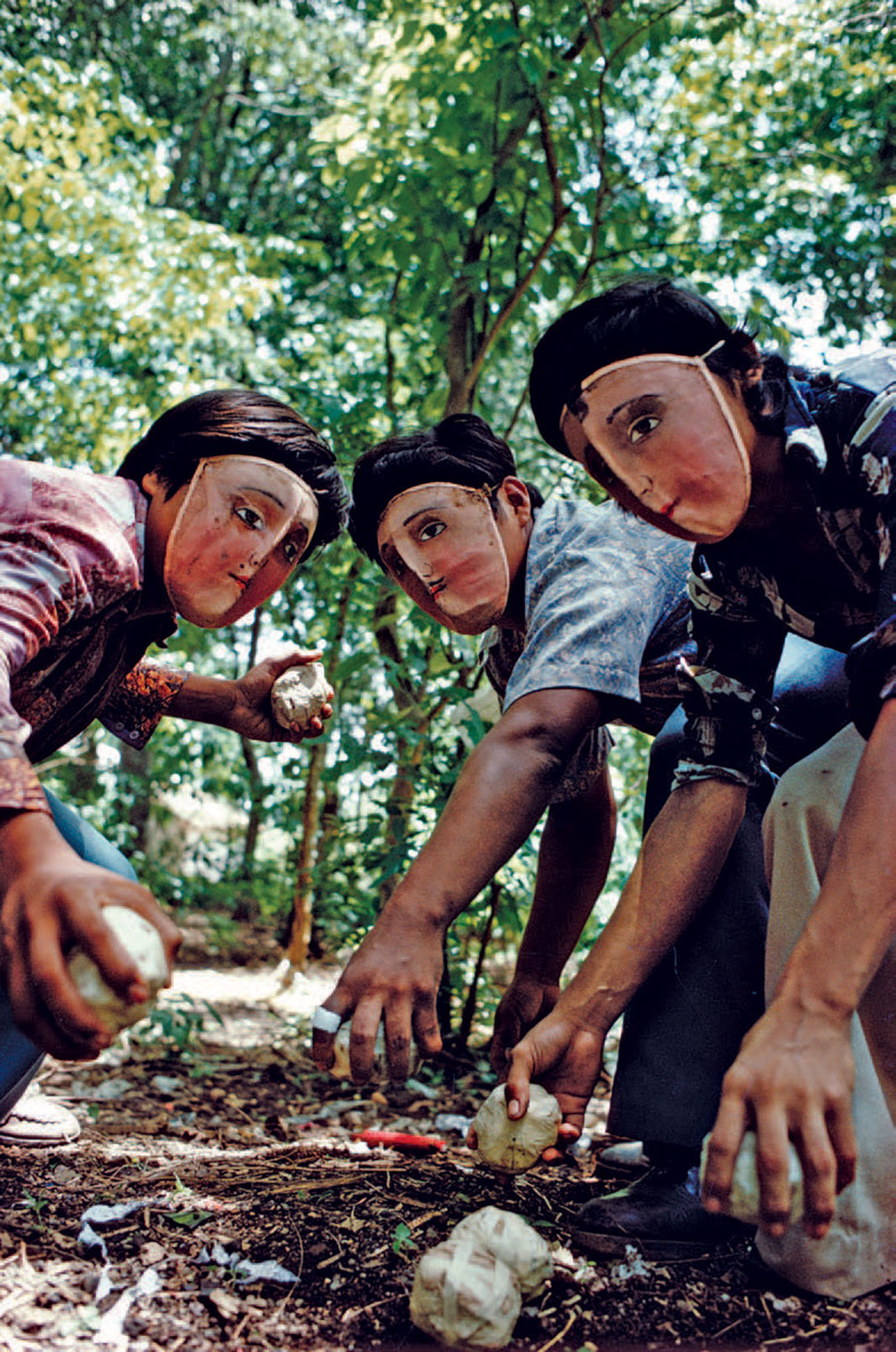"Susan Meiselas, Youths practice throwing contact bombs in forest surrounding Monimbo, 1978, C-print, 24 × 16""."