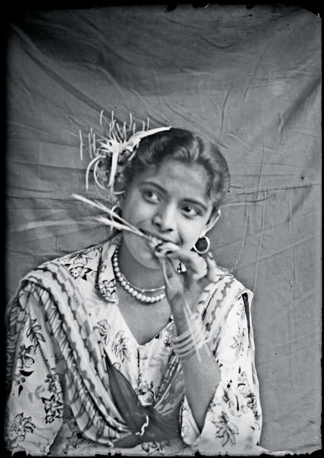 "Golam Kasem Daddy, Happy girl. Dacca, 1957, ink-jet print, 10 × 7""."