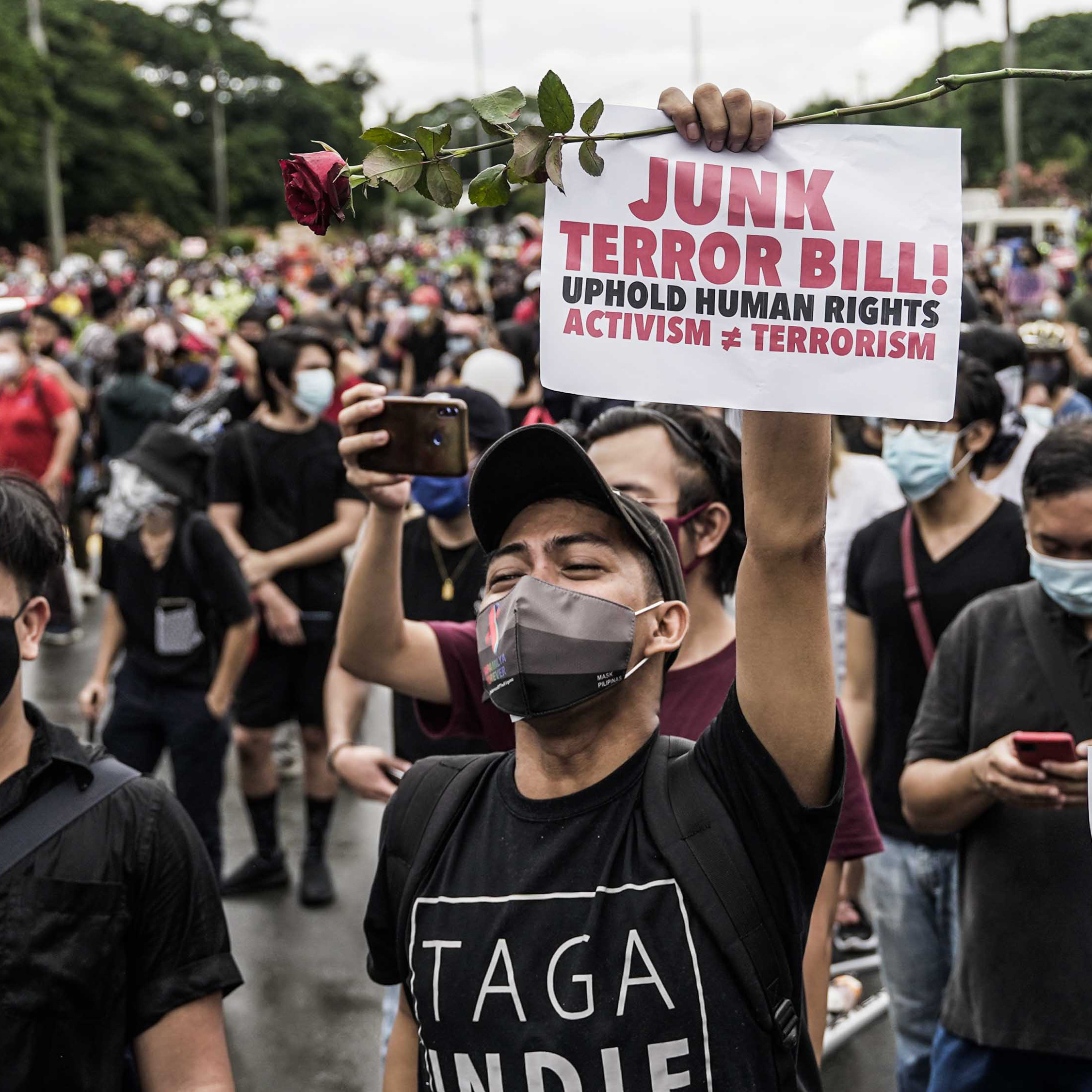 Protesters wearing face masks and shields carry anti-terror bill placards as they march at a university campus in Manila on June 12, 2020. Photo: Miggy Hilario/AFP via Getty Images.