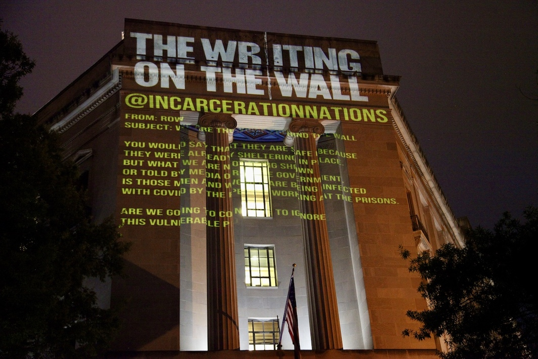 Hank Willis Thomas and Baz Dreisinger's The Writing on the Wall projected onto the US Department of Justice building. All photos: Liz Gorman.