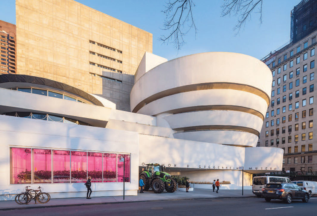 "Exterior view of ""Countryside, The Future,"" 2020, Solomon R. Guggenheim Museum, New York. From left: Industrial tomato-grow container; Deutz-Fahr TTV Warrior tractor. Photo: David Heald."